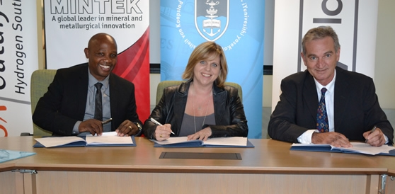 Dr Makhapa Makhafola, Dr Sharon Blair, and Piet Barnard signing the agreement